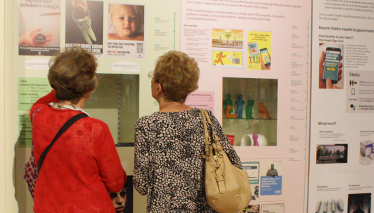 visitors looking at an exhibition, museum of brands