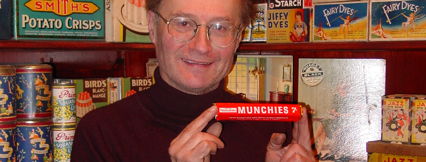 robert opie holding a package of munchies, museum of brands collection